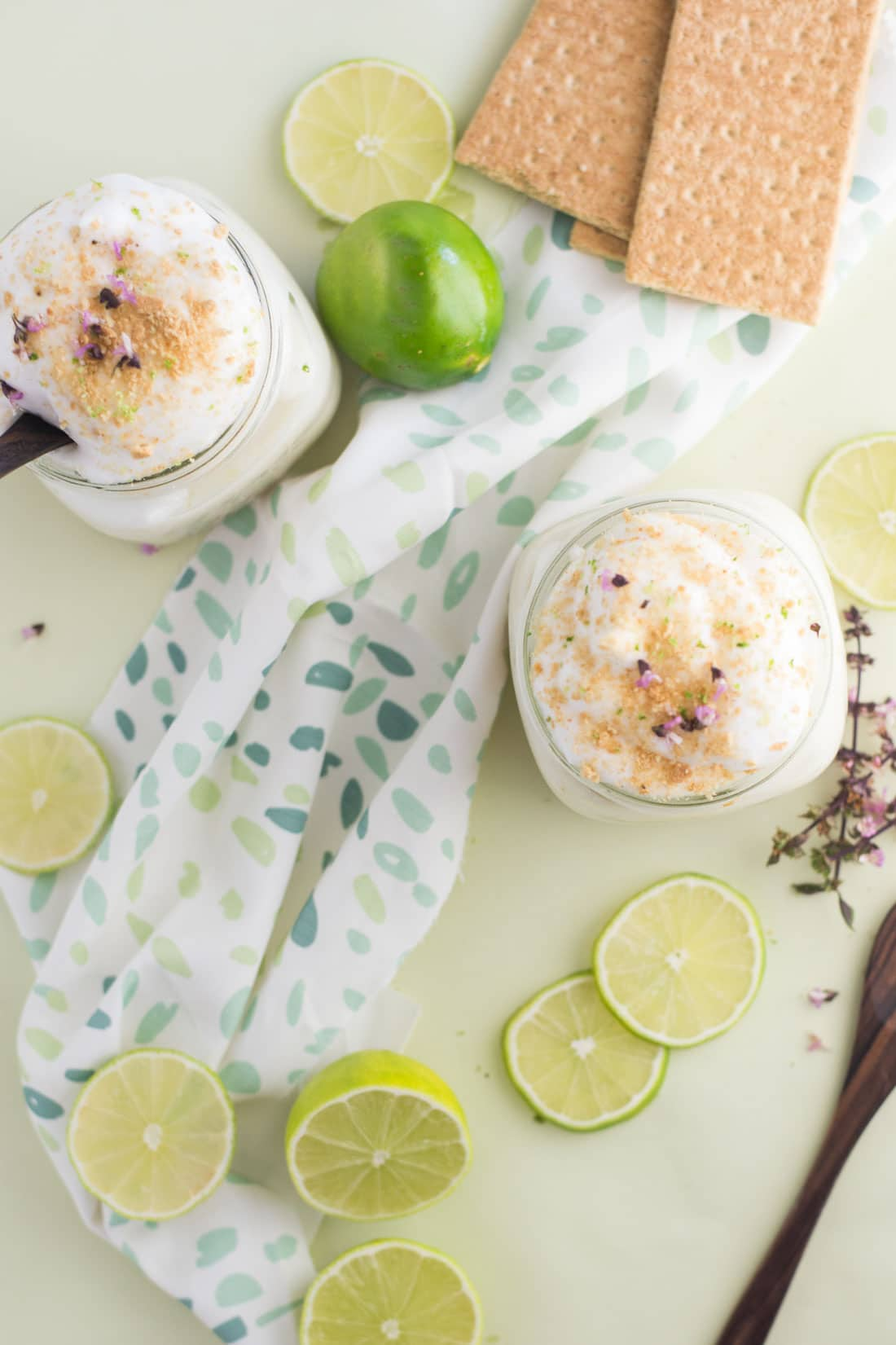vegan key lime pie parfaits with lime wedges and graham crackers