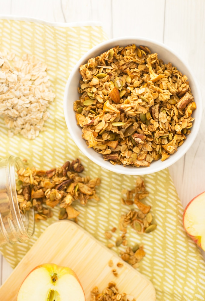 homemade granola on white wood background