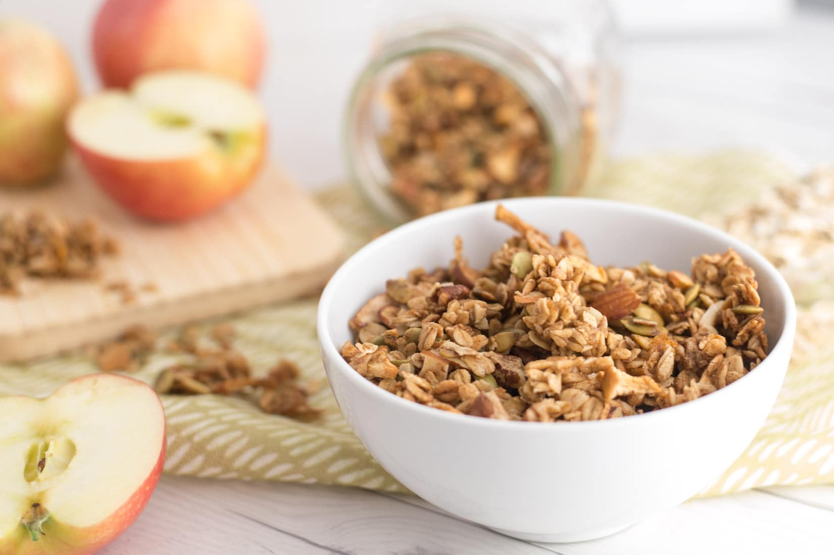 Chunky Apple Spice Granola -- Are you ready for Fall? This apple spice granola recipe is perfect for those chillier months. Made with REAL apples, maple syrup, and clusters of oats, this healthy homemade granola is delicious and is made with natural ingredients. Add this vegan and gluten free granola to your breakfast or snack. | mindfulavocado
