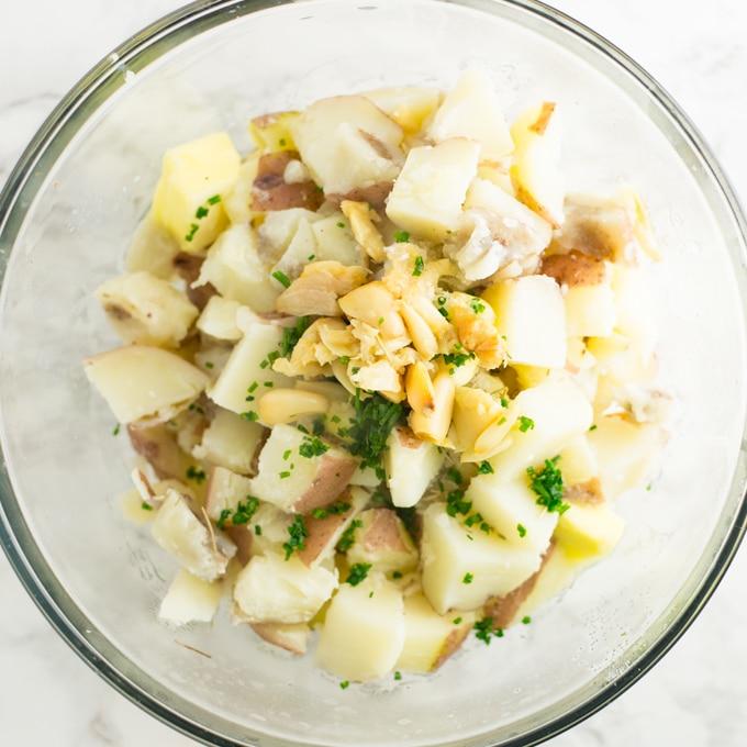 ingredients for roasted garlic mashed potatoes in mixing bowl