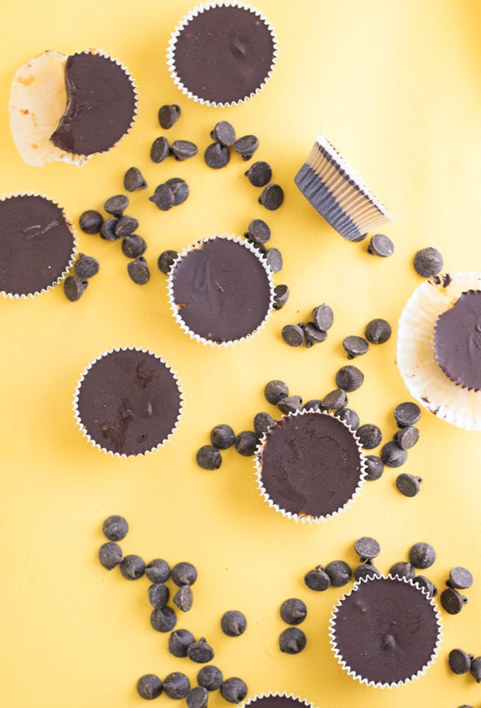 vegan mini chocolate peanut butter cups on yellow background