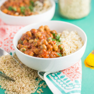 slow cooker vegan chana masala with rice on green background
