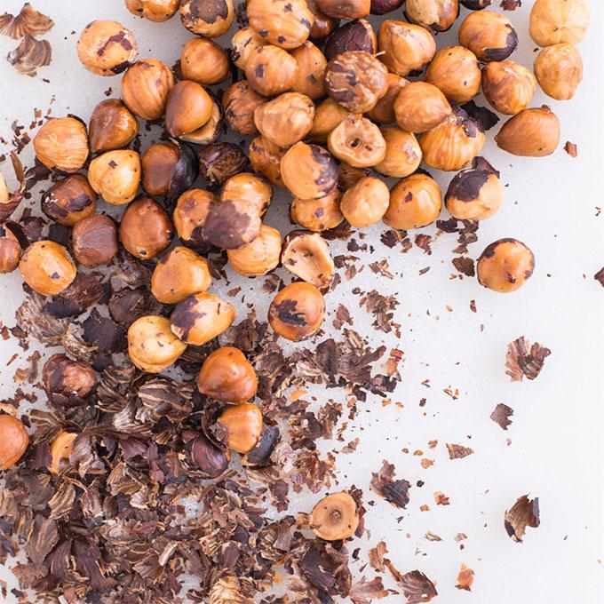 toasted hazelnuts on grey background