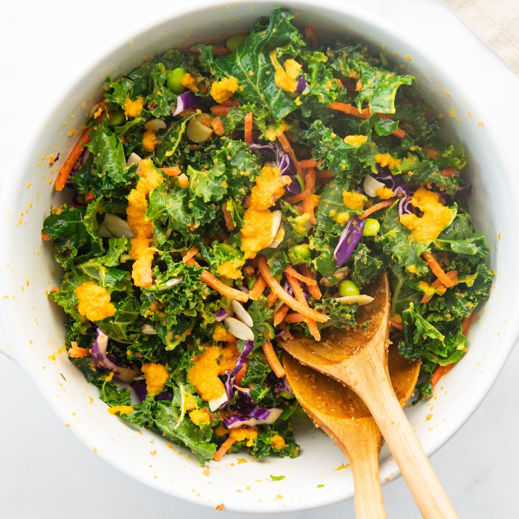 asian kale salad in mixing bowl
