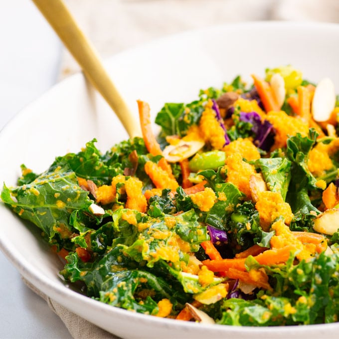 closeup of asian kale salad with carrots, cabbage, and edamame