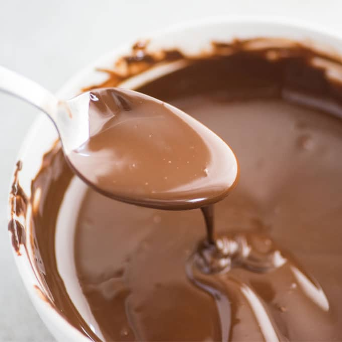 spoon over bowl of chocolate sauce