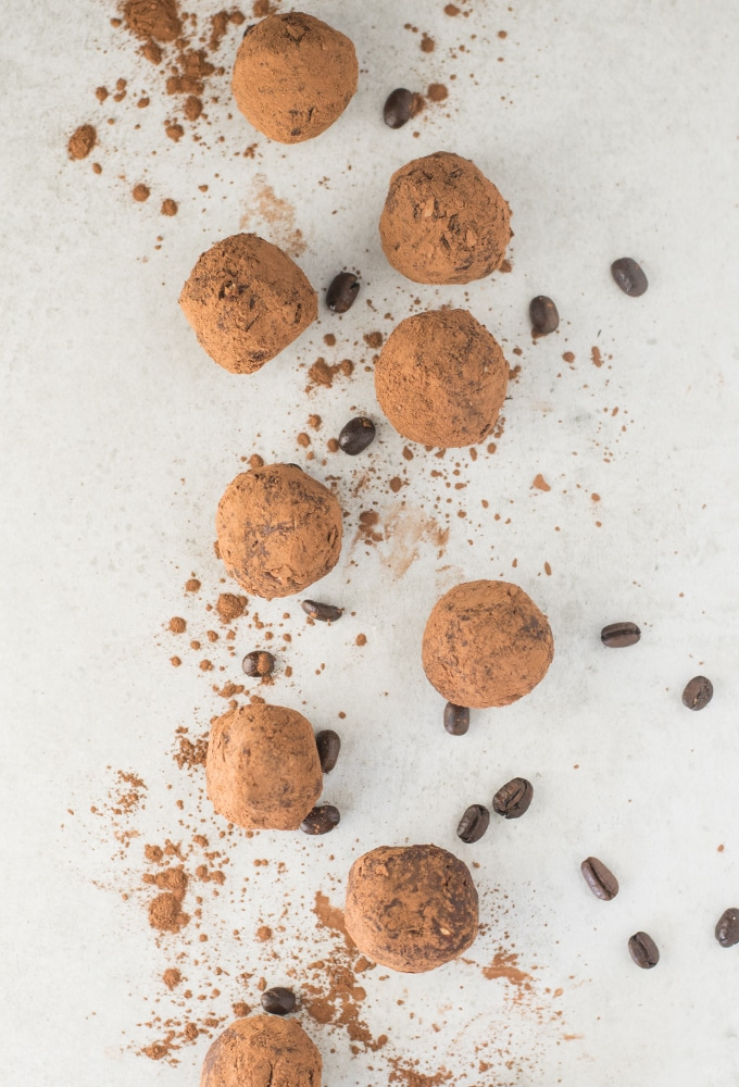 chocolate peanut butter energy bites with cocoa powder and coffee beans