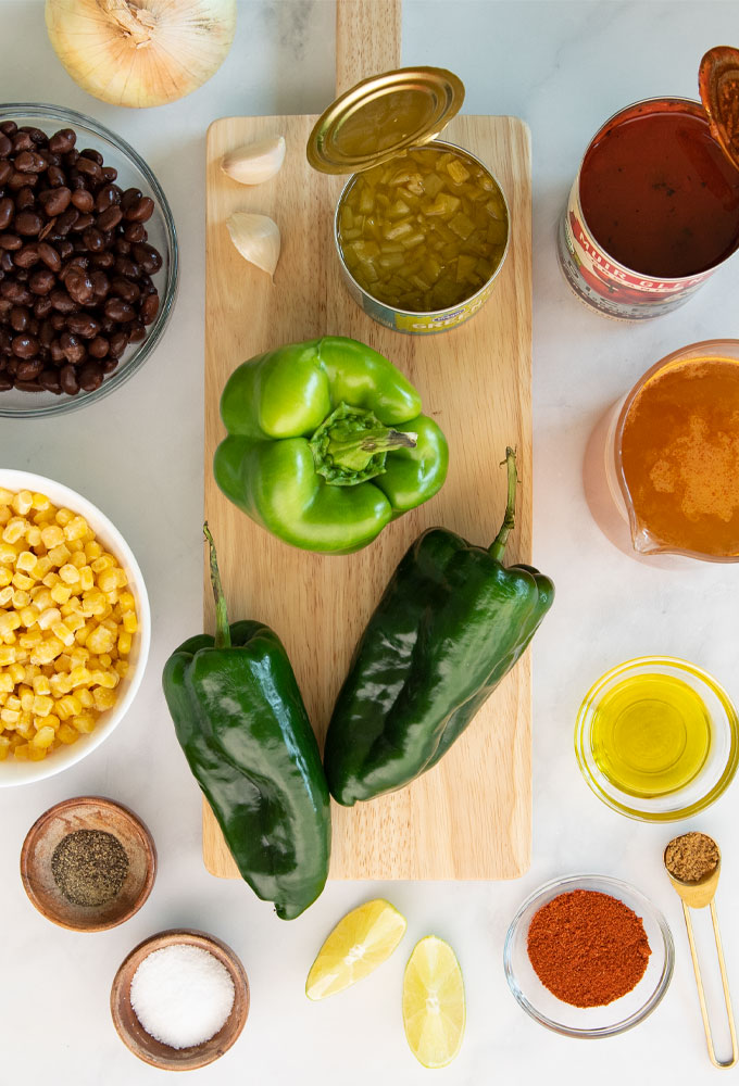 ingredients for southwestern soup on white background