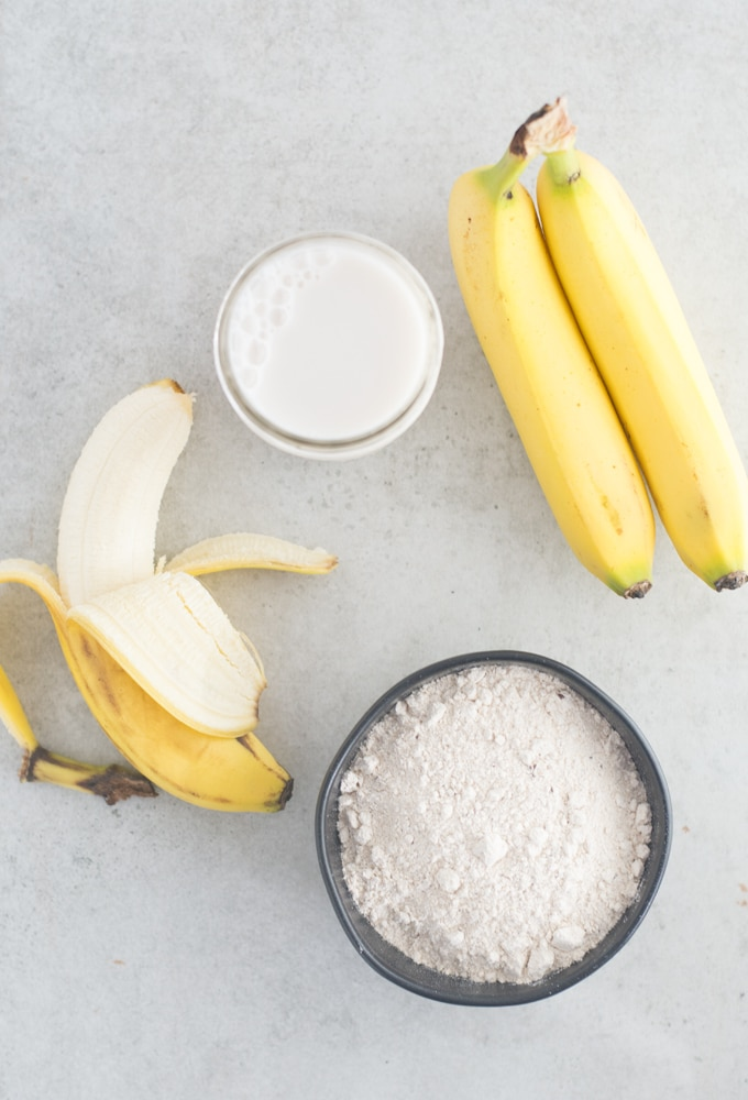 bananas, almond milk, and pancake mix on grey background