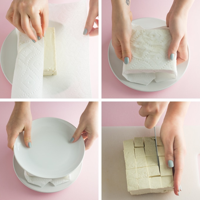 four step process of pressing tofu. handing wrapping tofu block with paper towel, hands pressing tofu, and hands cutting tofu block on cutting board