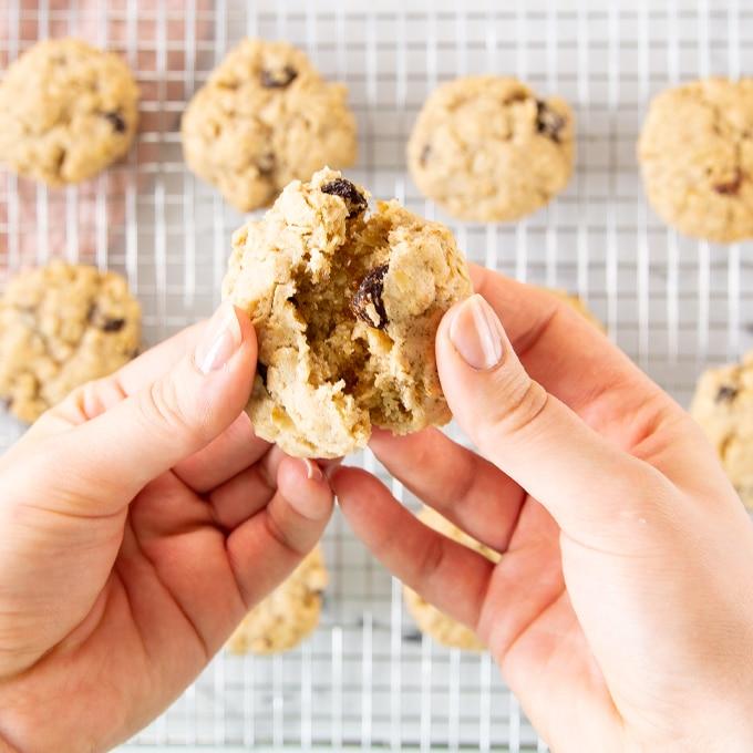 hands breaking cookie in half