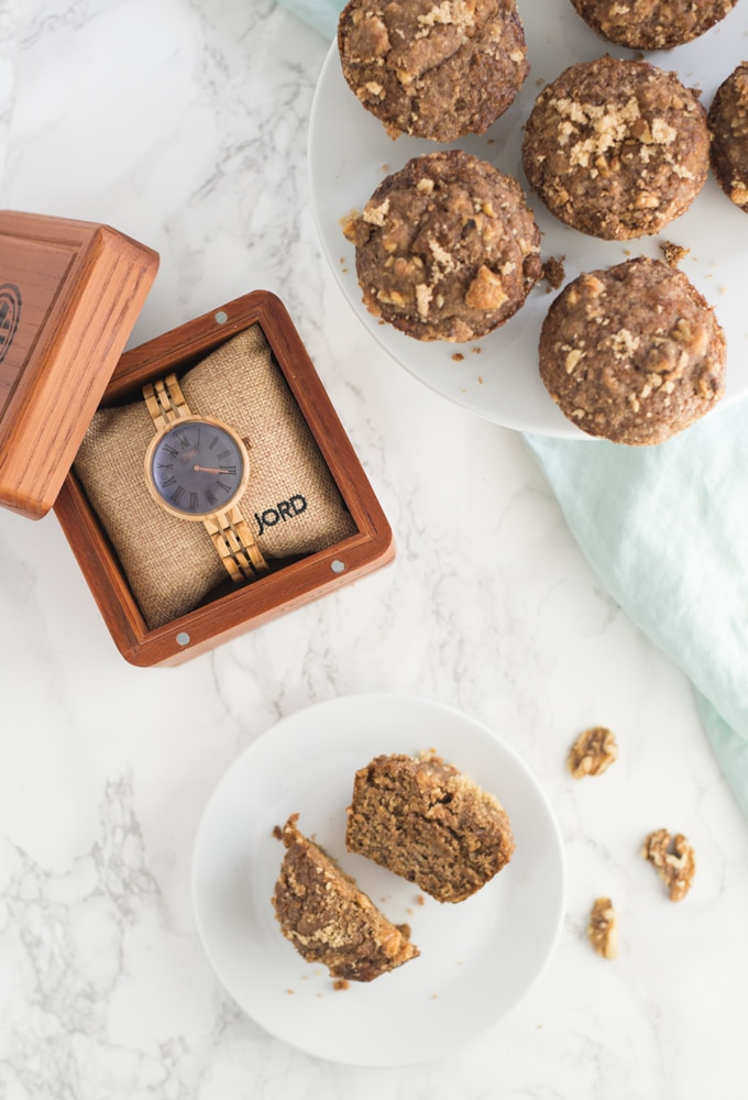 vegan banan muffins on white plate and cake stand with JORD wooden watch