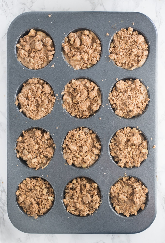 vegan banana muffins with strudel topping in muffin tin