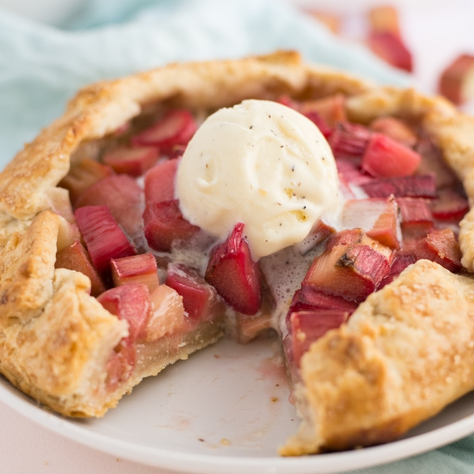 vegan rhubarb galette with vanilla ice cream with slice taken out