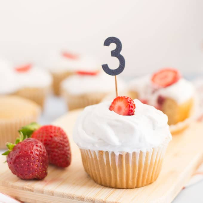 vegan strawberry shortcake cupcake with fresh strawberries for a third birthday