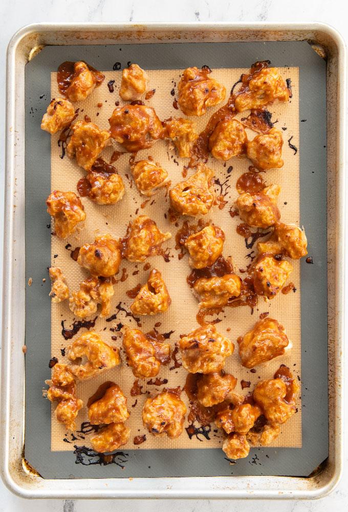 baked cauliflower bites on baking sheet
