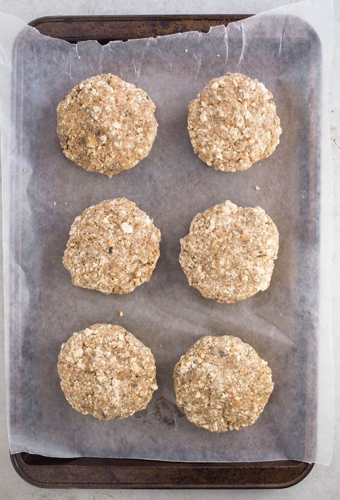 veggie burgers on baking sheet with parchment paper