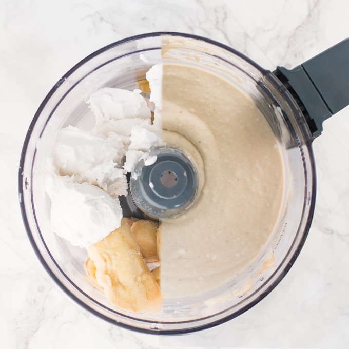 homemade vegan ice cream in a food processor. frozen bananas, coconut cream, and maple syrup.