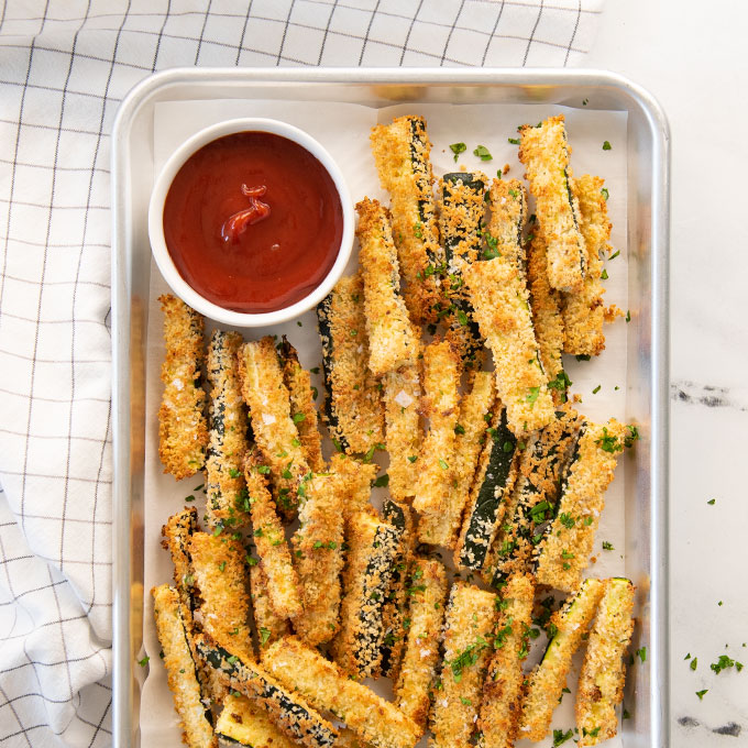 tray of zucchini fries with ketchup