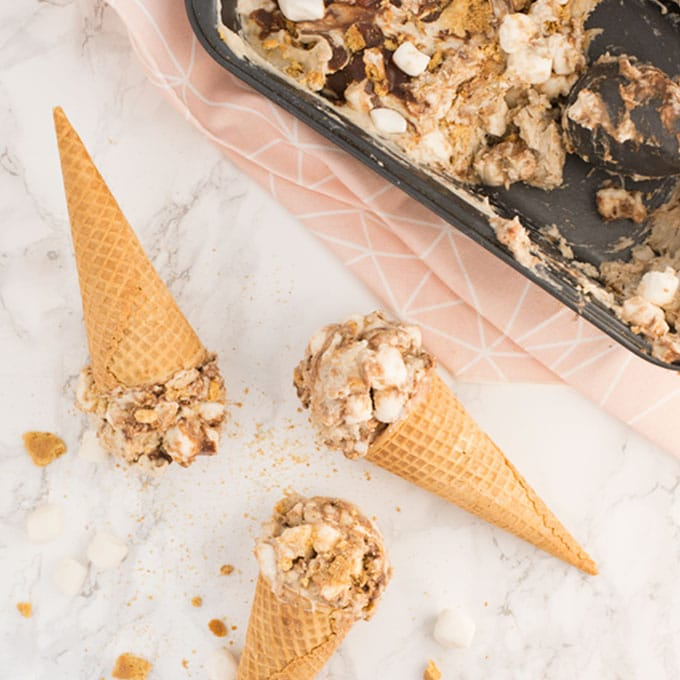 vegan smores ice cream cones on marble background with pink napkin