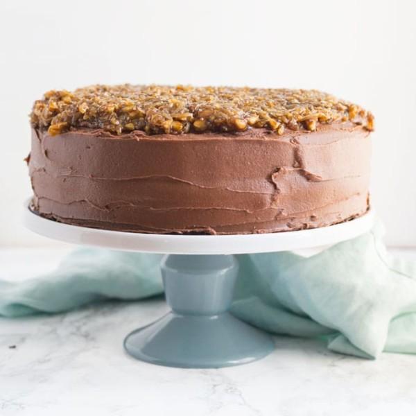 vegan German chocolate cake on a cake stand
