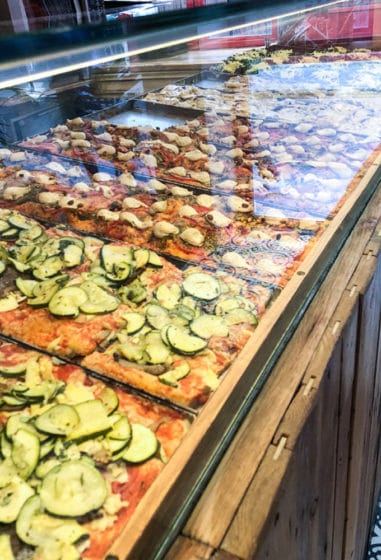 vegan pizza in display case at hank pizza in paris france