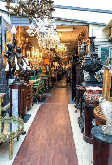 antiques at marche aux puces at-ouen in paris, france
