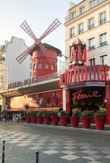moulin rogue on sunny day in paris, france