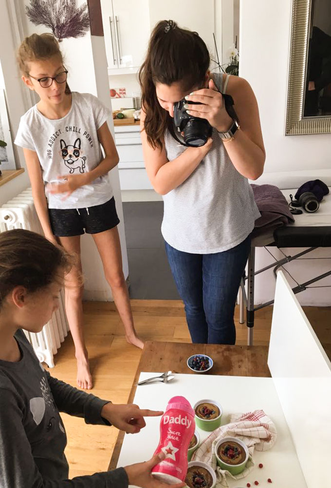 taking photo of chocolate mousse on white table