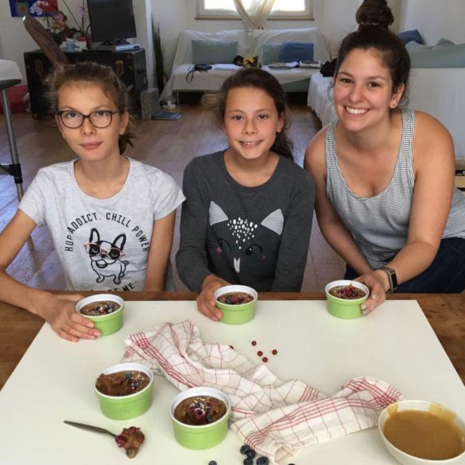 three girls holding chocolate mousse