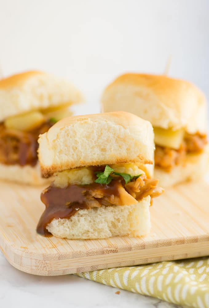 jackfruit sliders on wooden board with sauce