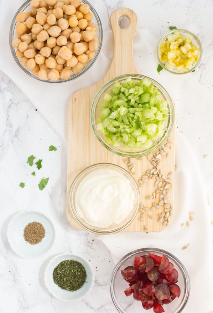 ingredients for vegan chickpea salad on white background
