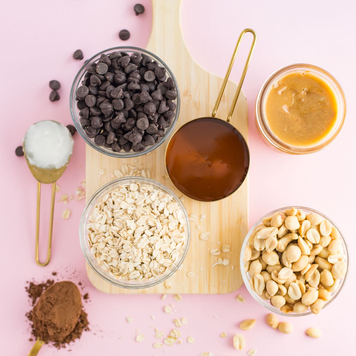 ingredients for homemade granola on pink background