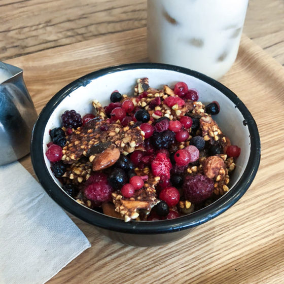granola bowl and iced chai latte from wild and moon - a vegan breakfast and lunch spot in paris, france