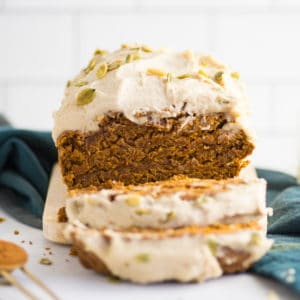 slices of vegan pumpkin bread with frosting