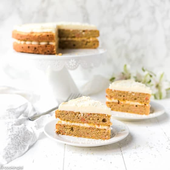 Slices of layered Keto Carrot Cake with Cream Cheese frosting