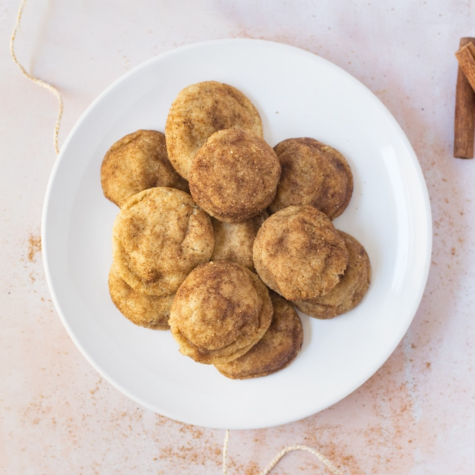 plate of vegan chai snickerdoodle cookies on light pink background