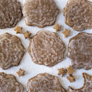 vegan gingerbread cookies with icing on white background