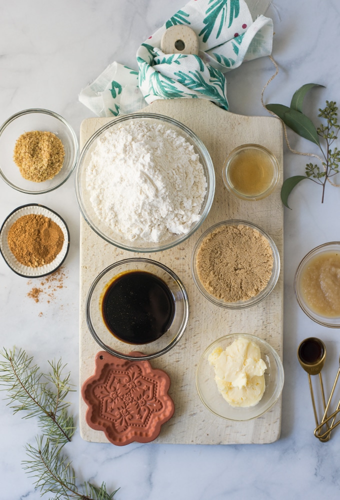 ingredients for vegan gingerbread cookies on marble background