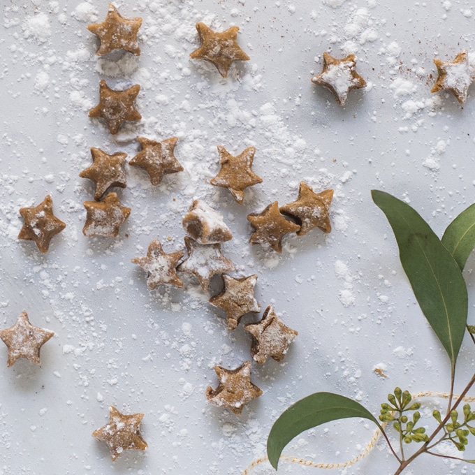 vegan gingerbread star cookies on white background