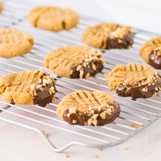 vegan and gluten free peanut butter cookies on cooling rack with chocolate