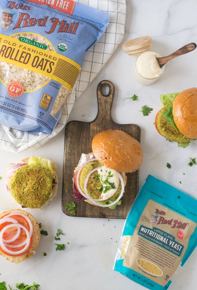 veggie burger on wood board with bobs red mill oats and nutritional yeast