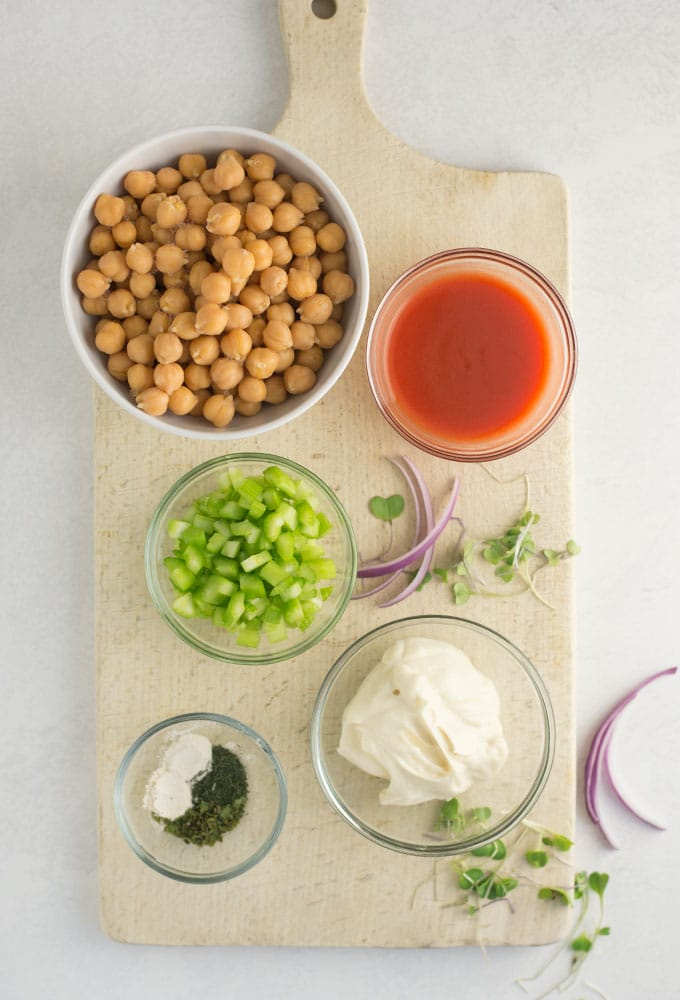 ingredients for buffalo chickpea salad on wood board