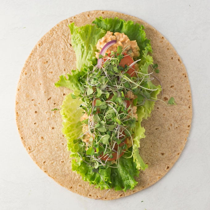 vegan wrap with lettuce, tomato, and sprouts