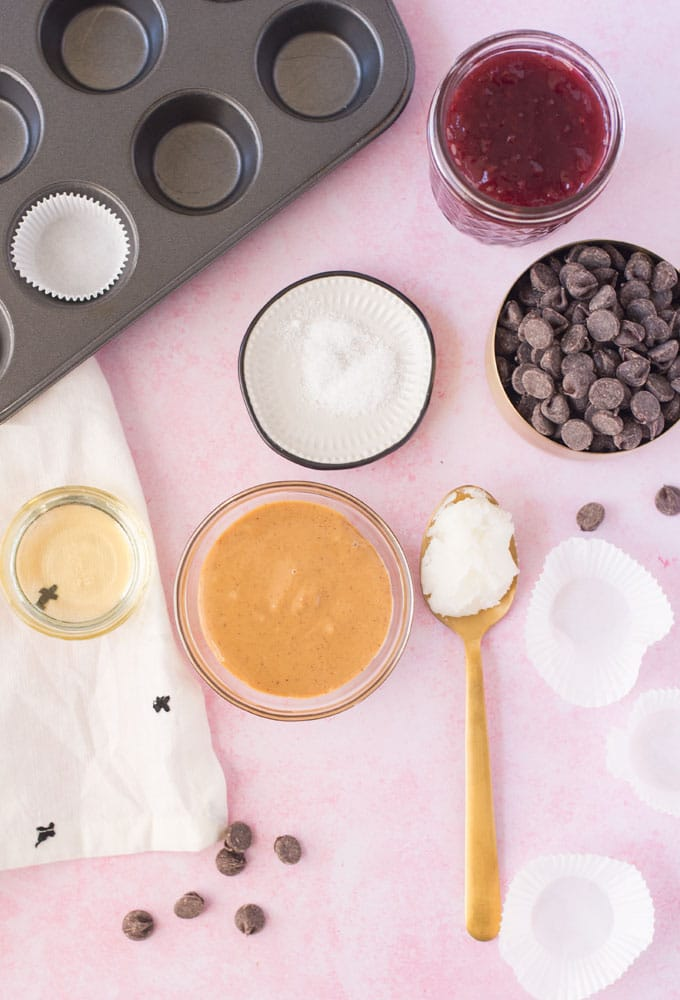 ingredients for homemade reeses on pink background