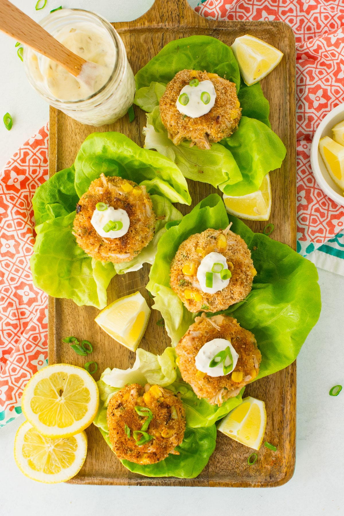 vegan crab cakes with tartar sauce, lemons, and green onions. Made with jackfruit