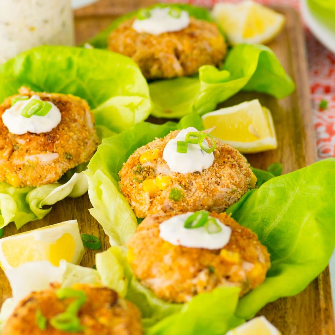 vegan crab cakes with jackfruit. served with lettuce, tartar sauce, and lemons