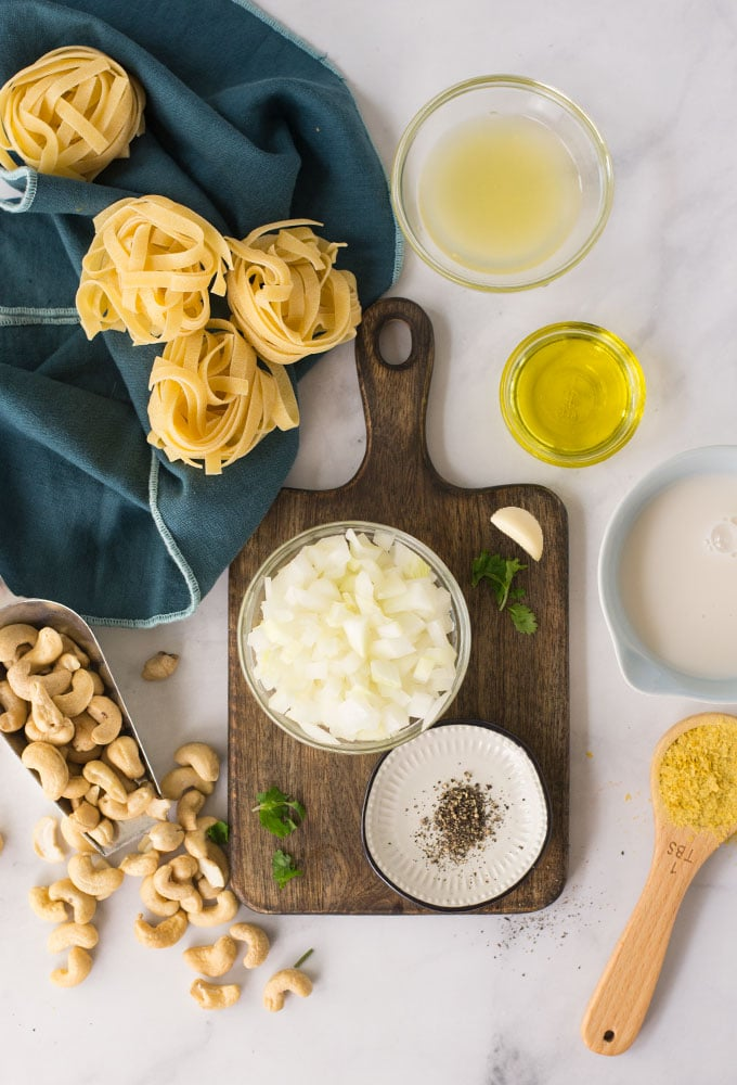 ingredients for vegan alfredo sauce on marble background