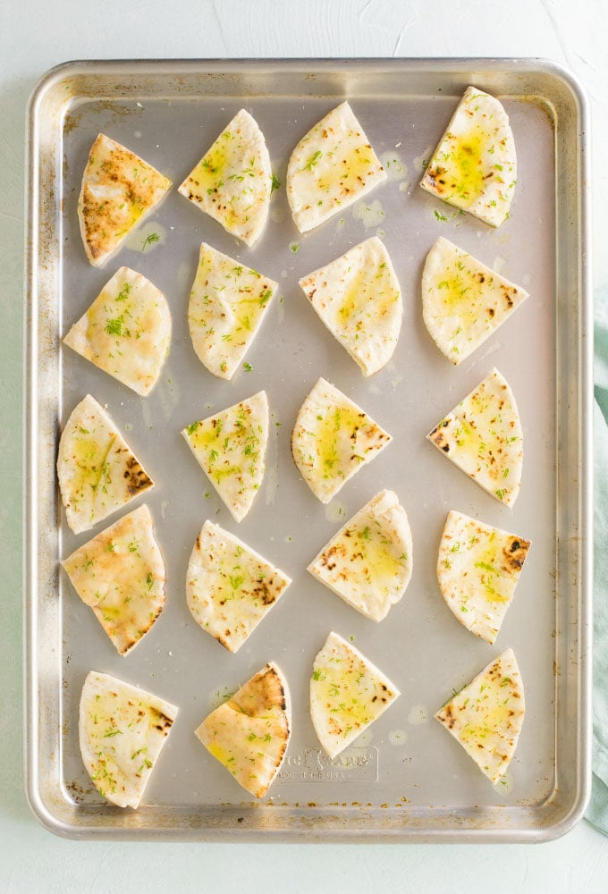 homemade pita chips on baking sheet
