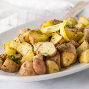roasted red potatoes with lemon and dill on serving platter